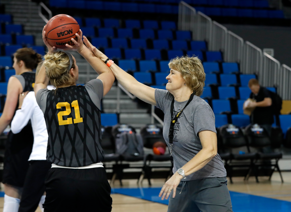 Iowa Hawkeyes head coach Lisa Bluder defends a shot by forward Hannah Stewart (21) during practice Friday, March 16, 2018 at Pauley Pavilion on the campus of UCLA. (Brian Ray/hawkeyesports.com)