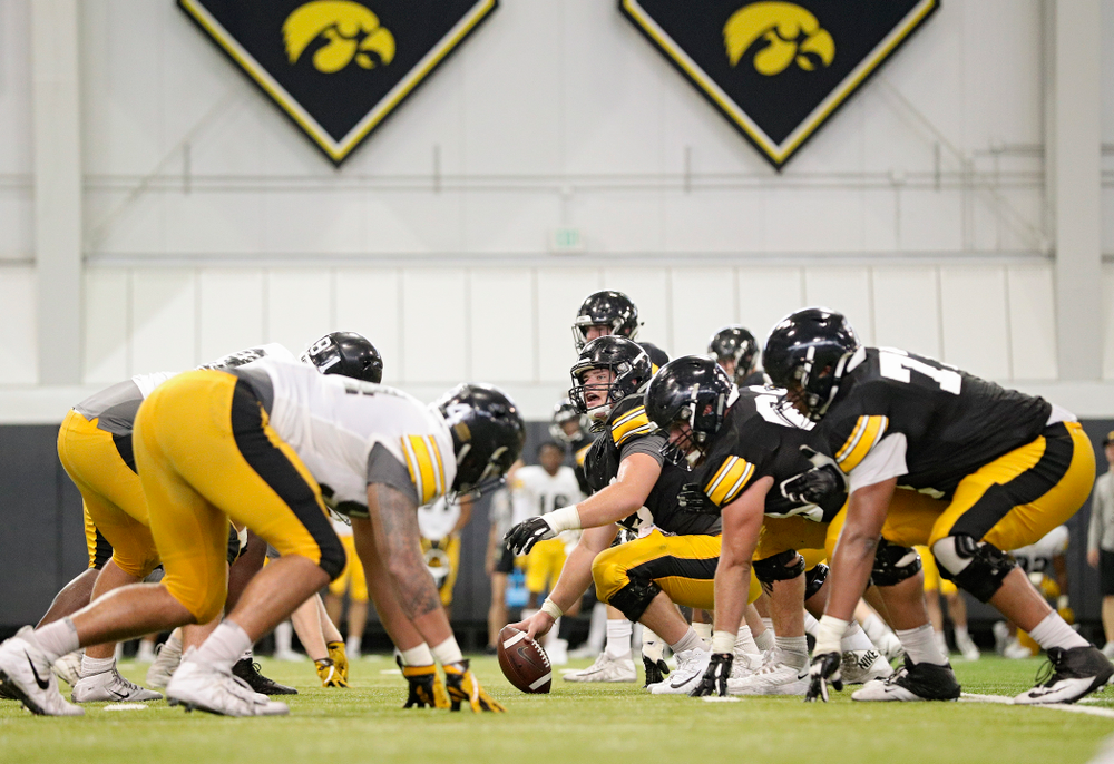 Iowa Hawkeyes offensive lineman Tyler Linderbaum (65) calls out at the line before snapping the ball during Fall Camp Practice No. 6 at the Hansen Football Performance Center in Iowa City on Thursday, Aug 8, 2019. (Stephen Mally/hawkeyesports.com)