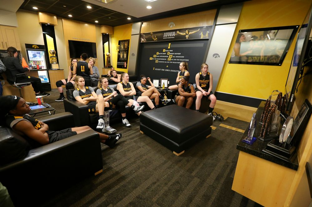 The Iowa Hawkeyes watch a basketball game on the television during media availability before their next game in the 2019 NCAA Women's Basketball Tournament at Carver Hawkeye Arena in Iowa City on Saturday, Mar. 23, 2019. (Stephen Mally for hawkeyesports.com)
