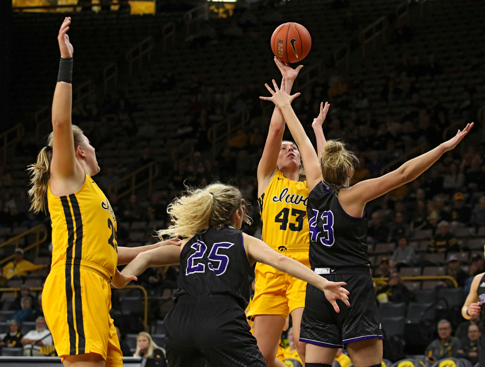 Iowa forward Amanda Ollinger (43) puts up a shot during the second quarter of their game against Winona State at Carver-Hawkeye Arena in Iowa City on Sunday, Nov 3, 2019. (Stephen Mally/hawkeyesports.com)