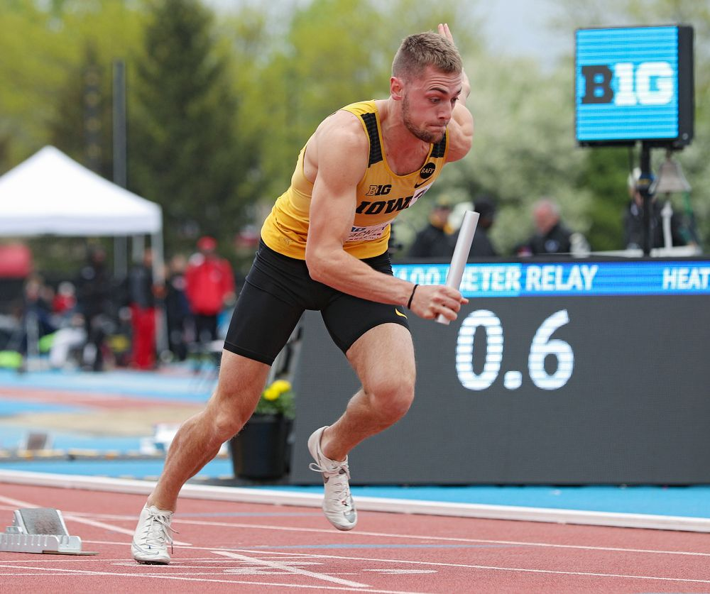 Iowa's Collin Hofacker runs his section of the men's 400 meter relay event on the third day of the Big Ten Outdoor Track and Field Championships at Francis X. Cretzmeyer Track in Iowa City on Sunday, May. 12, 2019. (Stephen Mally/hawkeyesports.com)