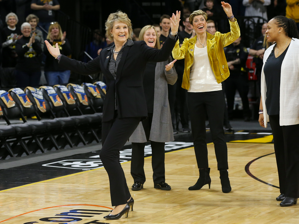 Iowa Hawkeyes head coach Lisa Bluder reacts after her daughter Emma Bluder (not pictured), didn't see her coming to hug her after Emma sung the National Anthem before their second round game in the 2019 NCAA Women's Basketball Tournament at Carver Hawkeye Arena in Iowa City on Sunday, Mar. 24, 2019. (Stephen Mally for hawkeyesports.com)