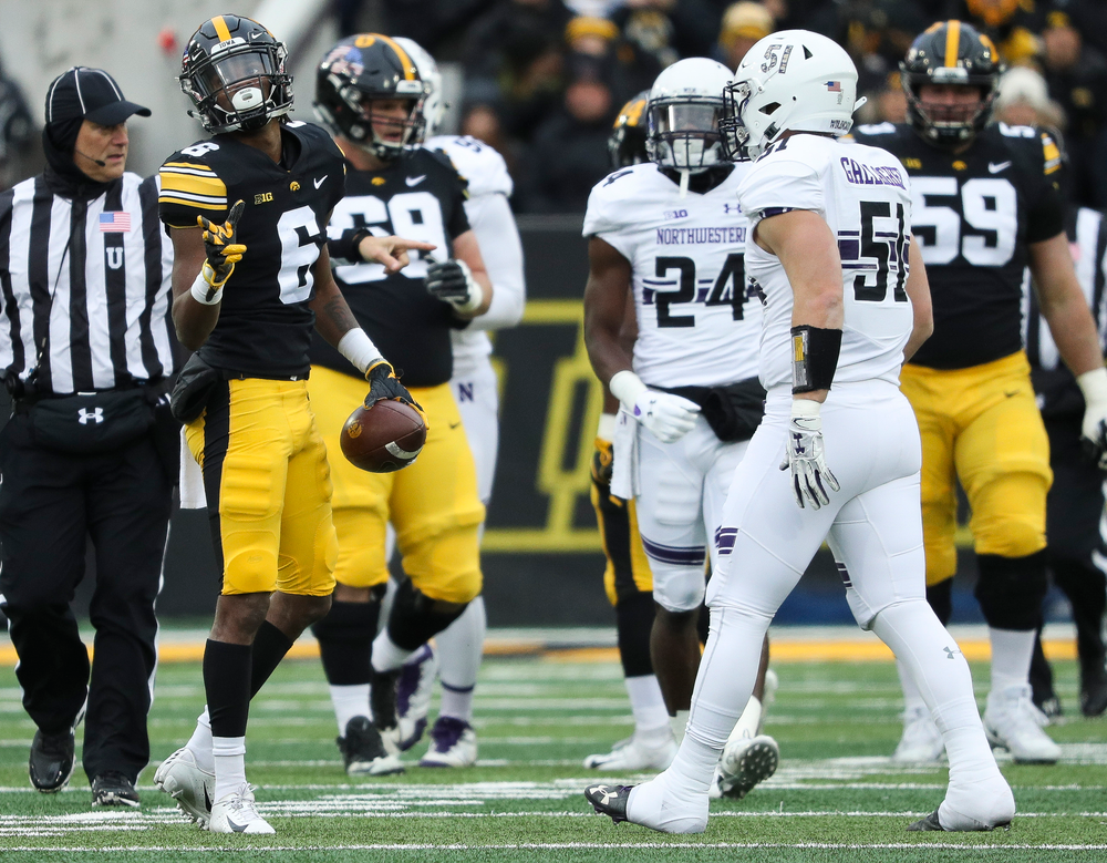 Iowa Hawkeyes wide receiver Ihmir Smith-Marsette (6) signals for a first down after making a reception during a game against Northwestern at Kinnick Stadium on November 10, 2018. (Tork Mason/hawkeyesports.com)