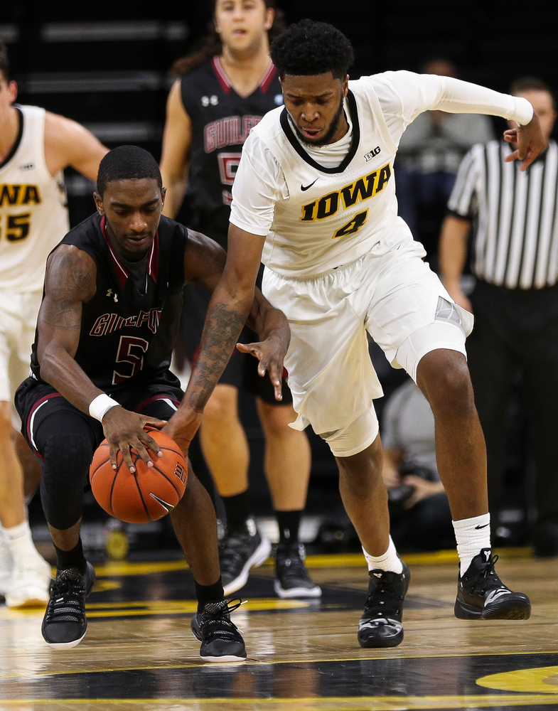 Iowa Hawkeyes guard Isaiah Moss (4) steals the ball during a game against Guilford College at Carver-Hawkeye Arena on November 4, 2018. (Tork Mason/hawkeyesports.com)