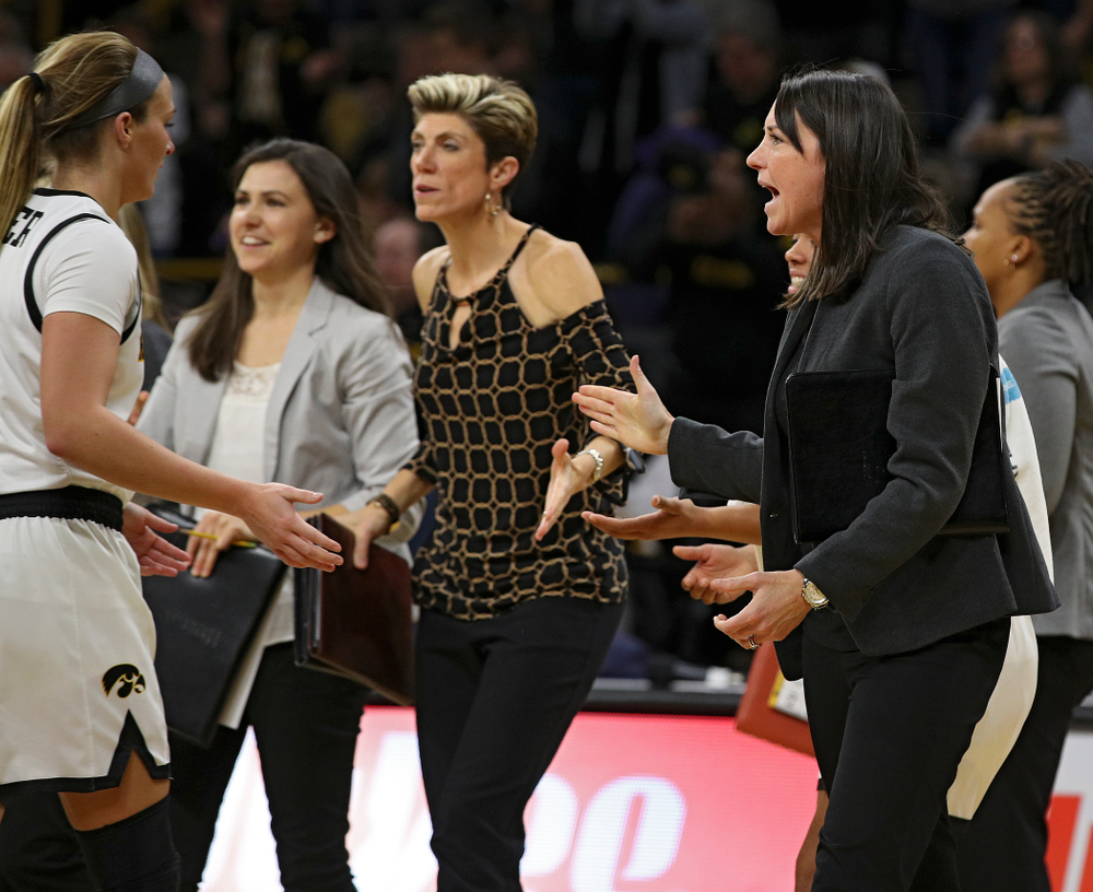 Iowa assistant coach Abby Stamp (right) gives a high-five to guard Makenzie Meyer (3) during the third quarter of their overtime win against Princeton at Carver-Hawkeye Arena in Iowa City on Wednesday, Nov 20, 2019. (Stephen Mally/hawkeyesports.com)