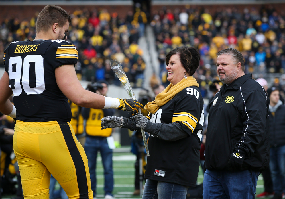 Iowa Hawkeyes defensive end Sam Brincks (90) is greeted by his parents during Senior Day ceremonies before a game against Nebraska at Kinnick Stadium on November 23, 2018. (Tork Mason/hawkeyesports.com)