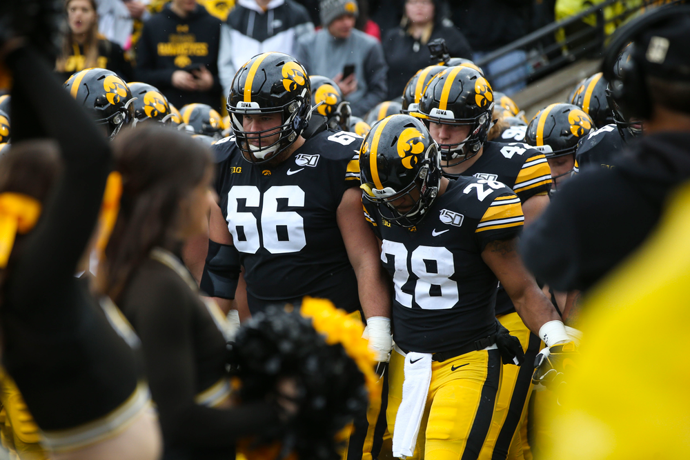 Iowa Hawkeyes offensive lineman Levi Paulsen (66) and  running back Toren Young (28) during Iowa football vs Purdue on Saturday, October 19, 2019 at Kinnick Stadium. (Lily Smith/hawkeyesports.com)