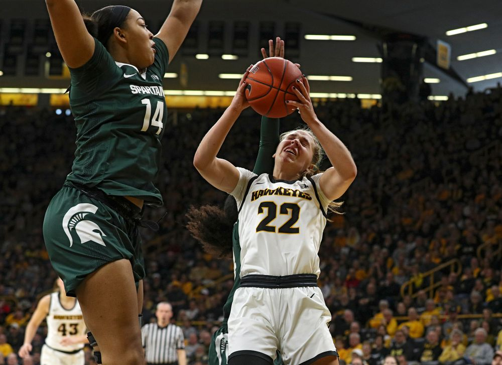 Iowa Hawkeyes guard Kathleen Doyle (22) makes a basket while being fouled during the first quarter of their game at Carver-Hawkeye Arena in Iowa City on Sunday, January 26, 2020. (Stephen Mally/hawkeyesports.com)