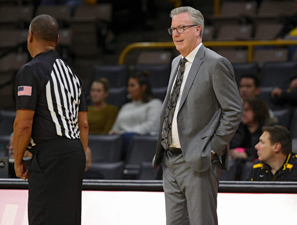 Iowa Hawkeyes head coach Fran McCaffery smiles as he talks with an official during the second half of their exhibition game against Lindsey Wilson College at Carver-Hawkeye Arena in Iowa City on Monday, Nov 4, 2019. (Stephen Mally/hawkeyesports.com)