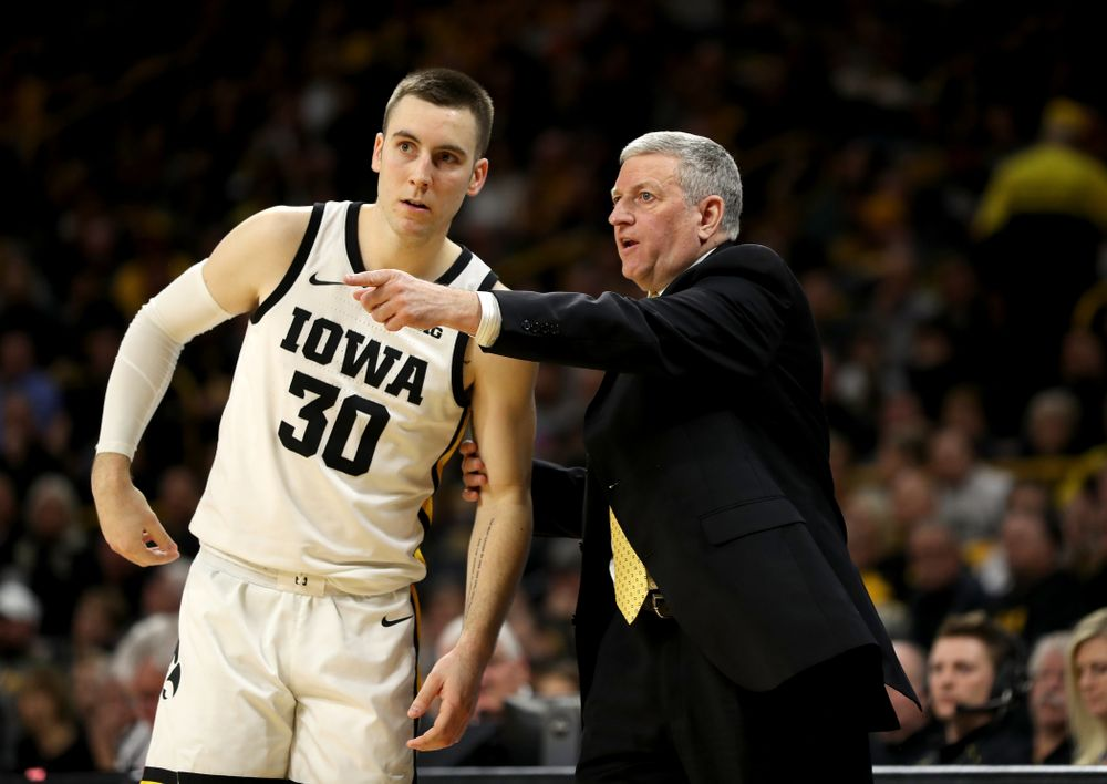 Iowa Hawkeyes guard Connor McCaffery (30) and assistant coach Kirk Speraw  against the Ohio State Buckeyes Thursday, February 20, 2020 at Carver-Hawkeye Arena. (Brian Ray/hawkeyesports.com)