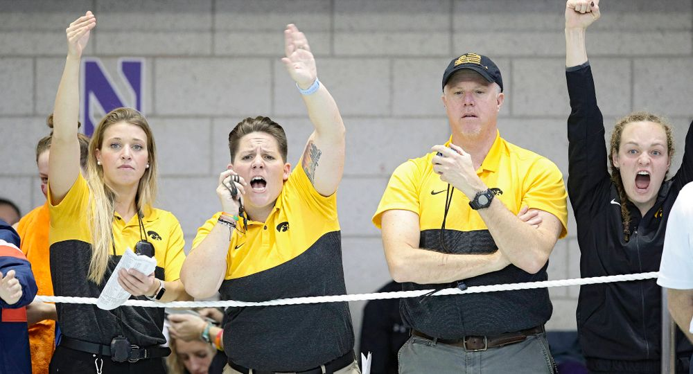 Iowa assistant coach Emma Sougstad (from left), assistant coach/women's recruiting coordinator Sarah Stockwell-Gregson, and assistant coach/men's recruiting coordinator Brian Schrader urge on Lauren McDougall (not pictured) as she swims the women's 500 yard freestyle preliminary event during the 2020 Women's Big Ten Swimming and Diving Championships at the Campus Recreation and Wellness Center in Iowa City on Thursday, February 20, 2020. (Stephen Mally/hawkeyesports.com)