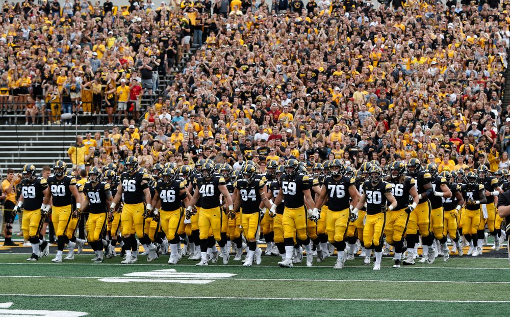 The Iowa Hawkeyes Swarm onto the field for their game against the Iowa State Cyclones Saturday, September 8, 2018 at Kinnick Stadium. (Brian Ray/hawkeyesports.com)