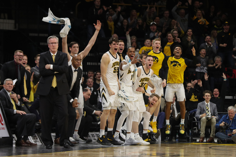 The Iowa Hawkeyes  celebrate a three point basket against the Michigan Wolverines Friday, February 1, 2019 at Carver-Hawkeye Arena. (Brian Ray/hawkeyesports.com)