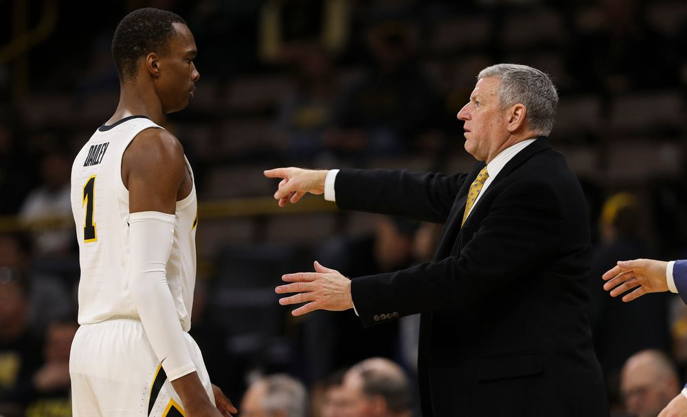 Iowa Hawkeyes assistant coach Kirk Speraw gives instructions to Iowa Hawkeyes guard Maishe Dailey (1) during a dead ball situation during a game against Guilford College at Carver-Hawkeye Arena on November 4, 2018. (Tork Mason/hawkeyesports.com)