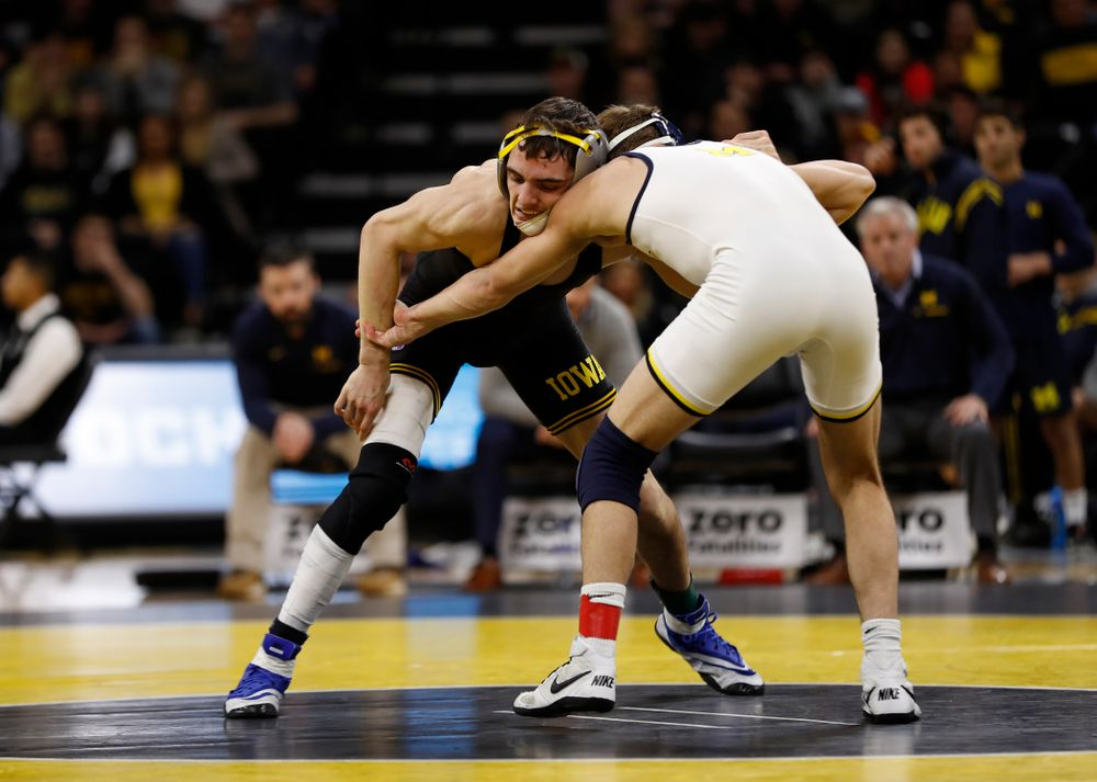 Iowa's Paul Glynn against Michigan's Stevan Micic at 133 pounds