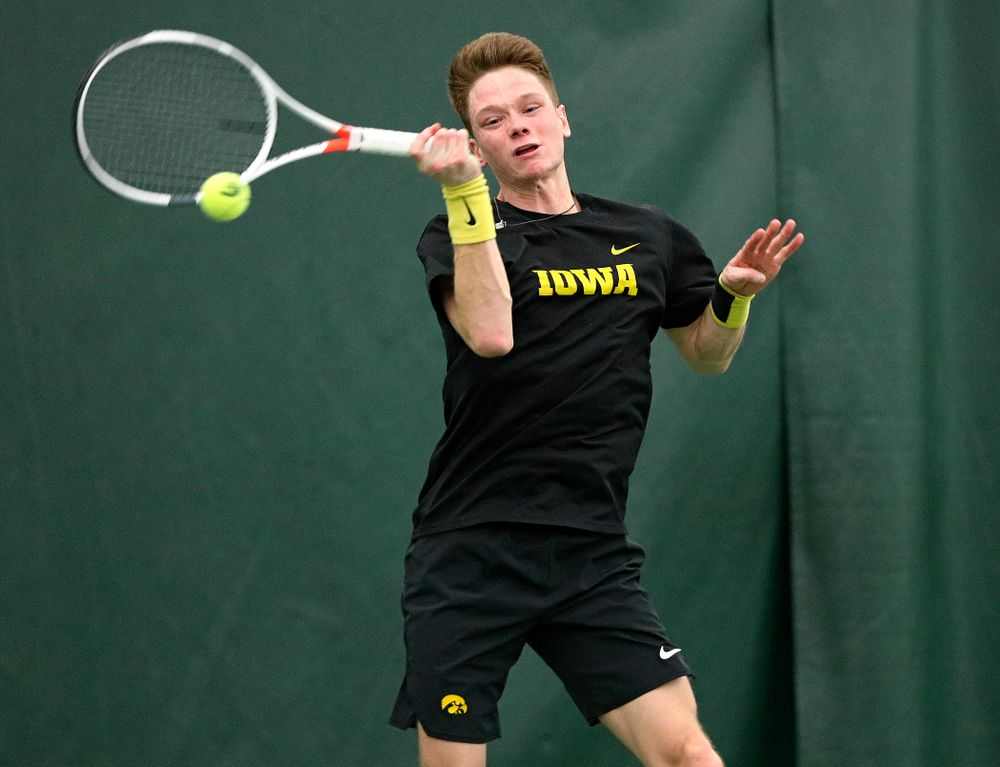 Iowa's Jason Kerst returns a shot during his singles match at the Hawkeye Tennis and Recreation Complex in Iowa City on Friday, February 14, 2020. (Stephen Mally/hawkeyesports.com)