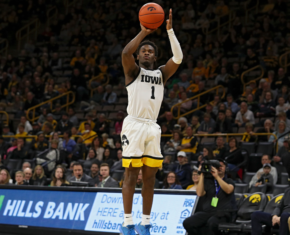 Iowa Hawkeyes guard Joe Toussaint (1) lines up a shot during the first half of their game at Carver-Hawkeye Arena in Iowa City on Sunday, Nov 24, 2019. (Stephen Mally/hawkeyesports.com)