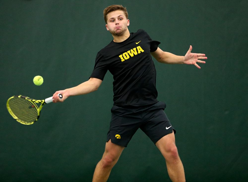 Iowa's Will Davies returns a shot during his singles match at the Hawkeye Tennis and Recreation Complex in Iowa City on Friday, February 14, 2020. (Stephen Mally/hawkeyesports.com)