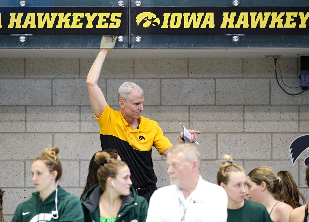 Iowa head coach Marc Long talks with his team during the 2020 Women's Big Ten Swimming and Diving Championships at the Campus Recreation and Wellness Center in Iowa City on Thursday, February 20, 2020. (Stephen Mally/hawkeyesports.com)