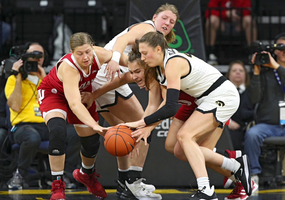 Iowa Hawkeyes forward Amanda Ollinger (43) tries to grab a loose ball as forward Monika Czinano (25) looks on during the second quarter of their game at Carver-Hawkeye Arena in Iowa City on Sunday, January 12, 2020. (Stephen Mally/hawkeyesports.com)