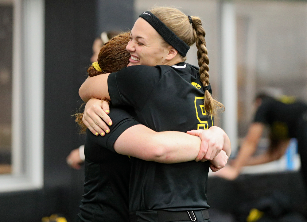 Iowa catcher/infielder Kate Claypool (from left) hugs utility player/catcher Abby Lien (9) during Iowa Softball Media Day at the Hawkeye Tennis and Recreation Complex in Iowa City on Thursday, January 30, 2020. (Stephen Mally/hawkeyesports.com)