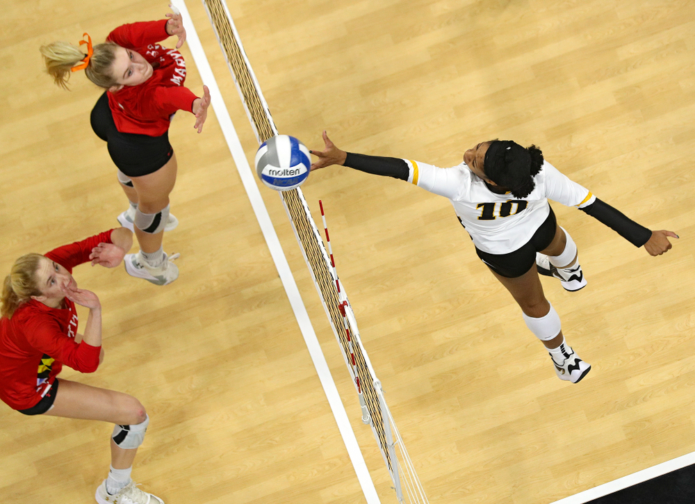 Iowa's Griere Hughes (10) tips the ball over the net during the second set of their match at Carver-Hawkeye Arena in Iowa City on Saturday, Nov 30, 2019. (Stephen Mally/hawkeyesports.com)