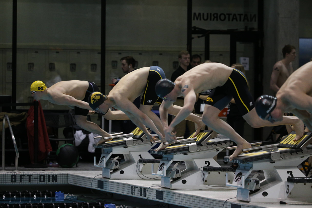 Iowa's Caleb Babb (center left) and Tanner Nelson (center right) at the 100-yard breaststroke race  Friday, March 1, 2019 at the Campus Recreation and Wellness Center. (Lily Smith/hawkeyesports.com)