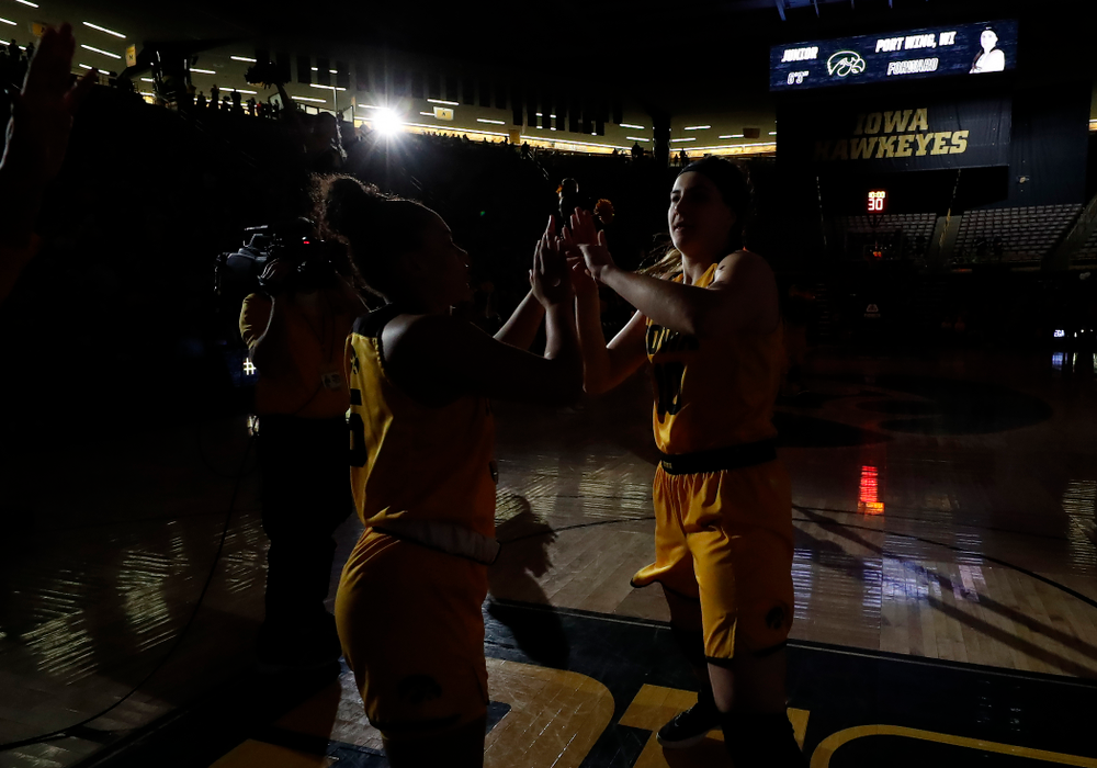 Iowa Hawkeyes forward Megan Gustafson (10) and guard Alexis Sevillian (5)