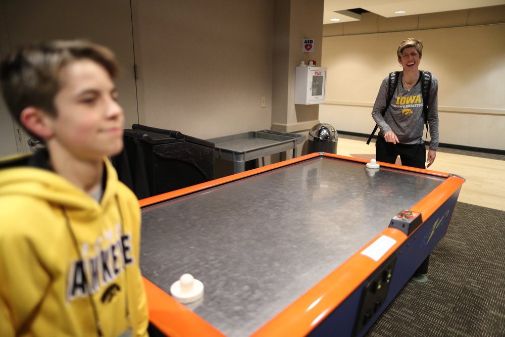 Associate head coach Jan Jensen plays air hockey with her son Jack following shoot around before their regional final against the Baylor Lady Bears in the 2019 NCAA Women's College Basketball Tournament Monday, April 1, 2019 at Greensboro Coliseum in Greensboro, NC.(Brian Ray/hawkeyesports.com)