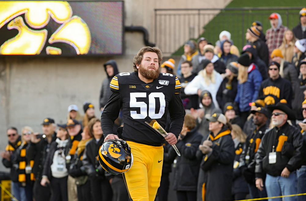Iowa Hawkeyes long snapper Jackson Subbert (50) is acknowledged on senior day before their game at Kinnick Stadium in Iowa City on Saturday, Nov 23, 2019. (Stephen Mally/hawkeyesports.com)