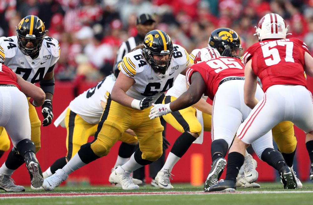 Iowa Hawkeyes offensive lineman Kyler Schott (64) against the Wisconsin Badgers Saturday, November 9, 2019 at Camp Randall Stadium in Madison, Wisc. (Brian Ray/hawkeyesports.com)
