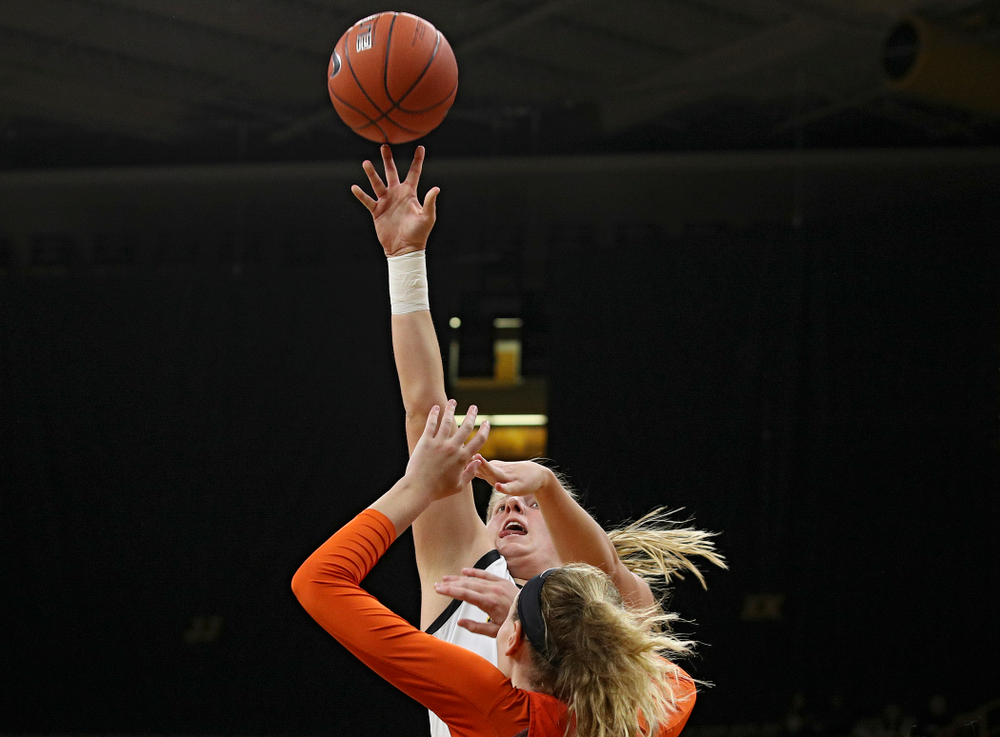 Iowa forward/center Monika Czinano (25) puts up a shot during the first quarter of their overtime win against Princeton at Carver-Hawkeye Arena in Iowa City on Wednesday, Nov 20, 2019. (Stephen Mally/hawkeyesports.com)