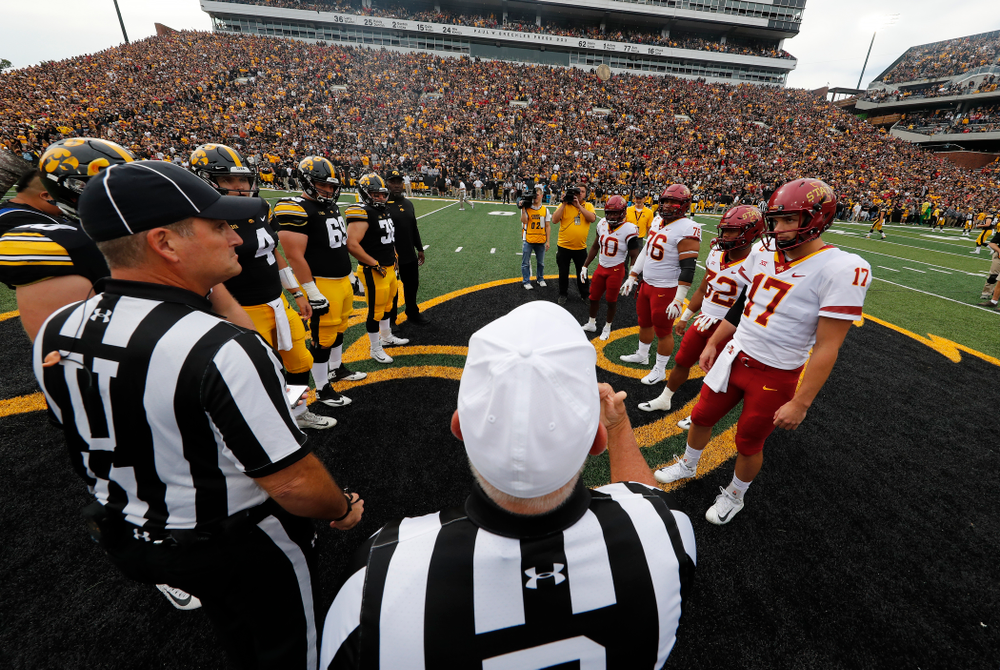 Iowa Hawkeyes captains defensive end Parker Hesse (40), quarterback Nate Stanley (4), offensive lineman Keegan Render (69), and fullback Brady Ross (36) stand for the coin toss against the Iowa State Cyclones Saturday, September 8, 2018 at Kinnick Stadium. (Brian Ray/hawkeyesports.com)