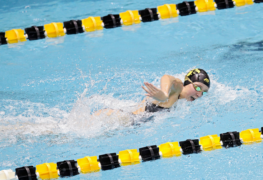 Iowa's Macy Rink swims the women's 100 yard individual medley event during their meet at the Campus Recreation and Wellness Center in Iowa City on Friday, February 7, 2020. (Stephen Mally/hawkeyesports.com)
