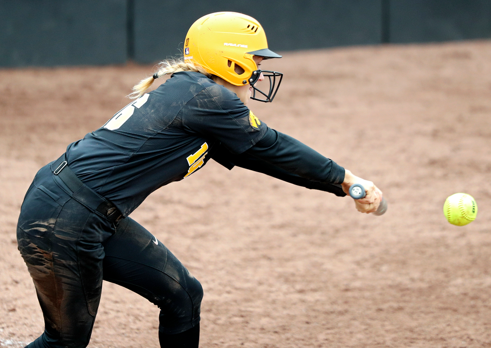 Iowa infielder Mia Ruther (26) lays down a bunt during the fifth inning of their game against Iowa Softball vs Indian Hills Community College at Pearl Field in Iowa City on Sunday, Oct 6, 2019. (Stephen Mally/hawkeyesports.com)
