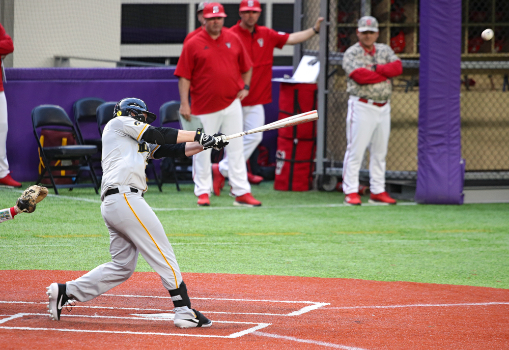 Iowa Hawkeyes outfielder Zeb Adreon (5) hits a double during the ninth inning of their CambriaCollegeClassic game at U.S. Bank Stadium in Minneapolis, Minn. on Friday, February 28, 2020. (Stephen Mally/hawkeyesports.com)