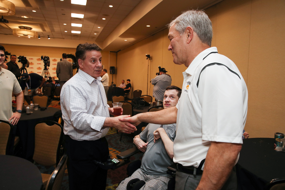 Iowa Hawkeyes head coach Kirk Ferentz shakes hands with Outback Bowl CEO Jim McVay during the Outback Bowl coaches press conference Saturday, December 29, 2018 in Tampa, FL. (Brian Ray/hawkeyesports.com)