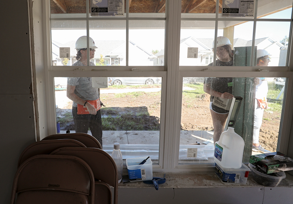 Iowa assistant coach Abby Stamp (from left) and McKenna Warnock work on a Habitat for Humanity Women Build project in Iowa City on Wednesday, Sep 25, 2019. (Stephen Mally/hawkeyesports.com)