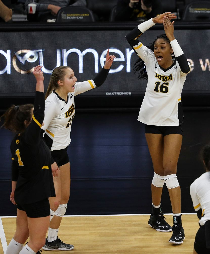 Iowa Hawkeyes outside hitter Taylor Louis (16) celebrates after winning a point during a match against Maryland at Carver-Hawkeye Arena on November 23, 2018. (Tork Mason/hawkeyesports.com)