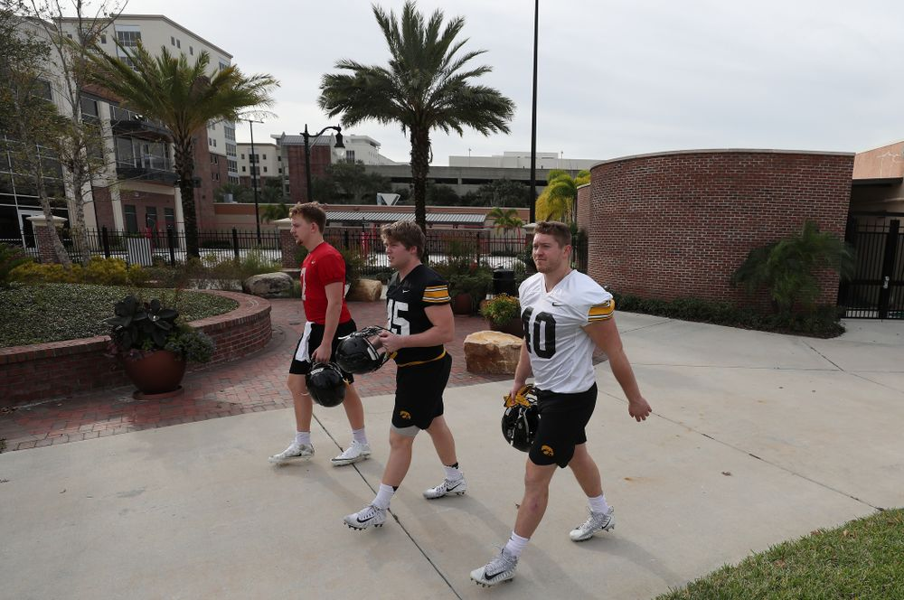 Iowa Hawkeyes defensive end Parker Hesse (40), fullback Joe Ludwig (45), and quarterback Spencer Petras (7) during the team's first Outback Bowl Practice in Florida Thursday, December 27, 2018 at Tampa University. (Brian Ray/hawkeyesports.com)