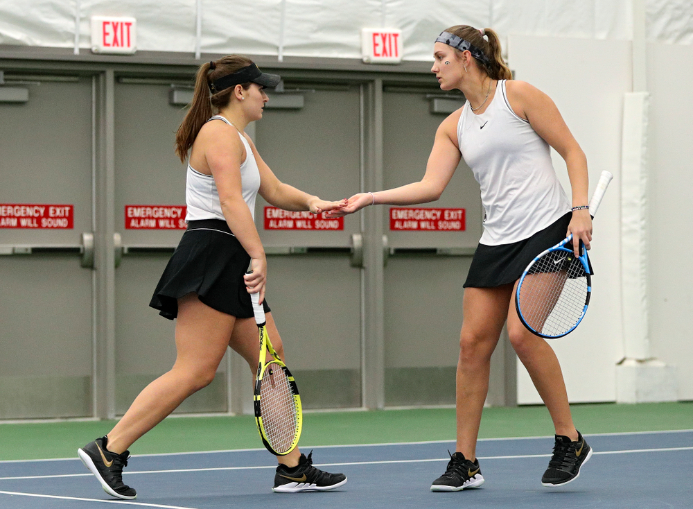 Iowa's Danielle Bauers (from left) and Ashleigh Jacobs celebrate a point during their doubles match at the Hawkeye Tennis and Recreation Complex in Iowa City on Sunday, February 16, 2020. (Stephen Mally/hawkeyesports.com)