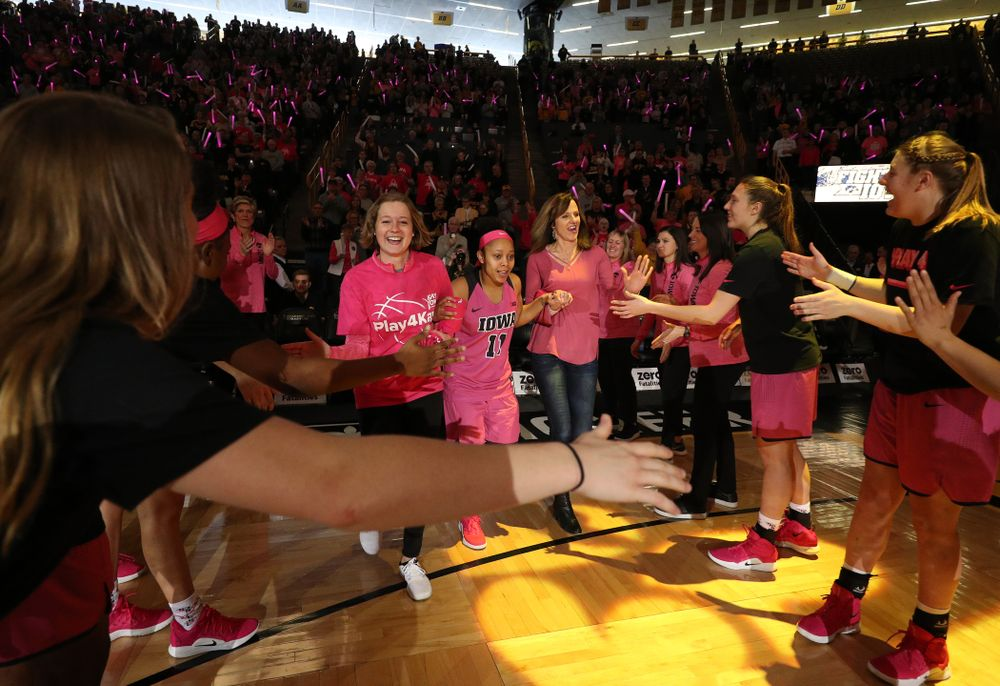 Iowa Hawkeyes guard Tania Davis (11)  is introduced with a cancer survivor before their game against the seventh ranked Maryland Terrapins Sunday, February 17, 2019 at Carver-Hawkeye Arena. (Brian Ray/hawkeyesports.com)