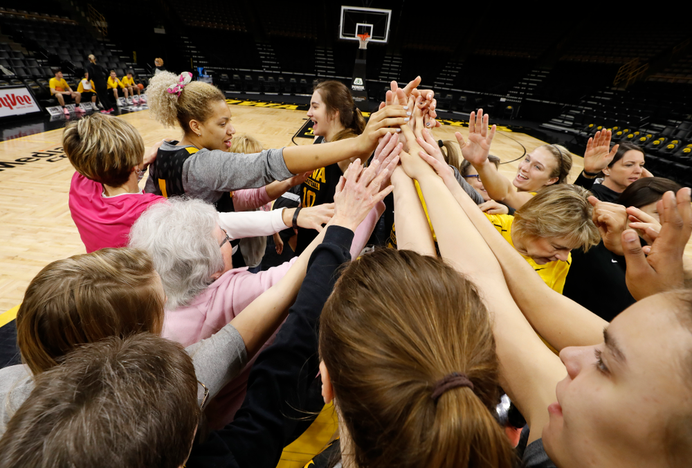 Cancer survivors tell their stories to the Iowa Women's Basketball team following their shoot around