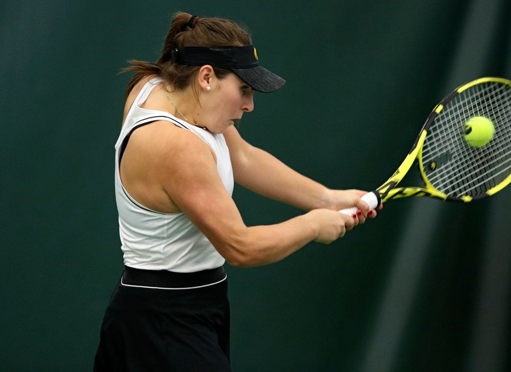 Iowa's Danielle Bauers returns a shot during her doubles match at the Hawkeye Tennis and Recreation Complex in Iowa City on Sunday, February 16, 2020. (Stephen Mally/hawkeyesports.com)