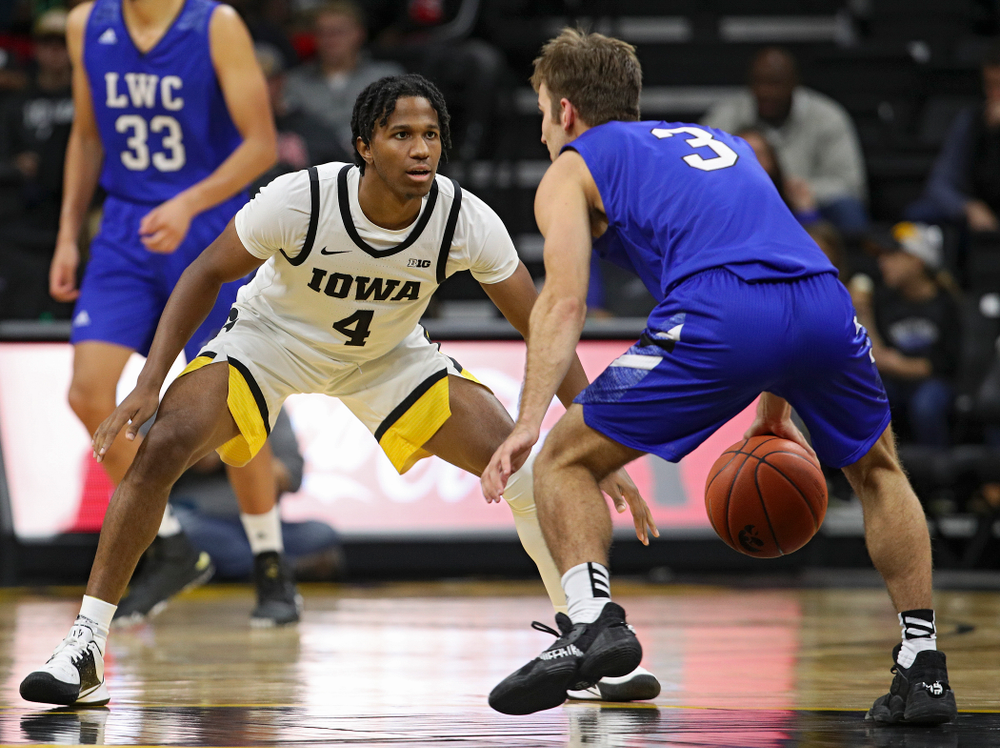 Iowa Hawkeyes guard Bakari Evelyn (4) eyes a player during the second half of their exhibition game against Lindsey Wilson College at Carver-Hawkeye Arena in Iowa City on Monday, Nov 4, 2019. (Stephen Mally/hawkeyesports.com)
