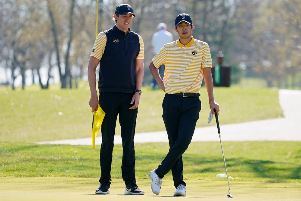 Iowa assistant coach Charlie Hoyle (from left) talks with Joe Kim during the third round of the Hawkeye Invitational at Finkbine Golf Course in Iowa City on Sunday, Apr. 21, 2019. (Stephen Mally/hawkeyesports.com)