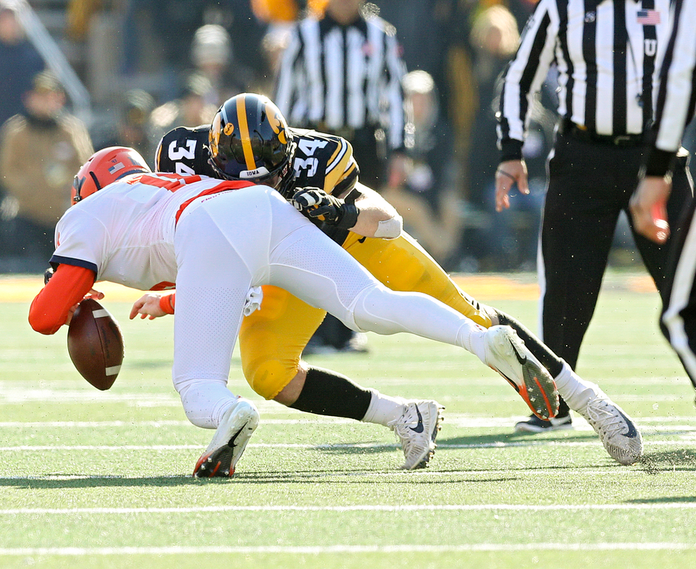 Iowa Hawkeyes linebacker Kristian Welch (34) forces Illinois Fighting Illini quarterback Brandon Peters (18) to fumble the ball during the fourth quarter of their game at Kinnick Stadium in Iowa City on Saturday, Nov 23, 2019. (Stephen Mally/hawkeyesports.com)