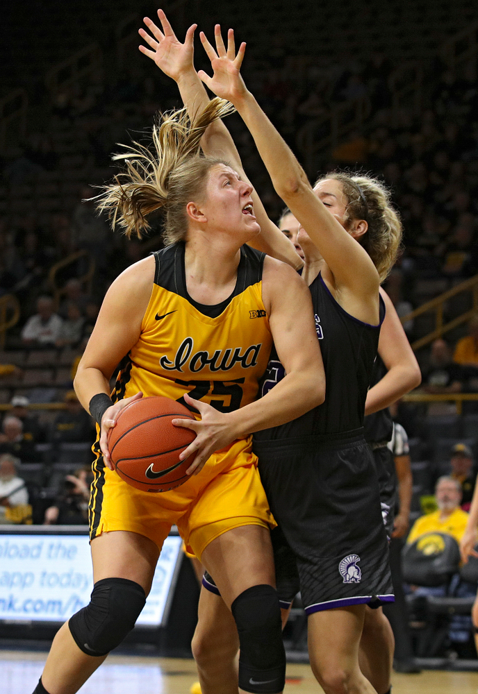 Iowa forward/center Monika Czinano (25) eyes the basket during the second quarter of their game against Winona State at Carver-Hawkeye Arena in Iowa City on Sunday, Nov 3, 2019. (Stephen Mally/hawkeyesports.com)