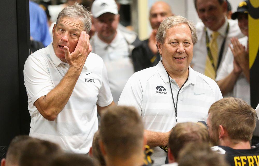 Iowa Hawkeyes head coach Kirk Ferentz, University of Iowa President Bruce Harreld
