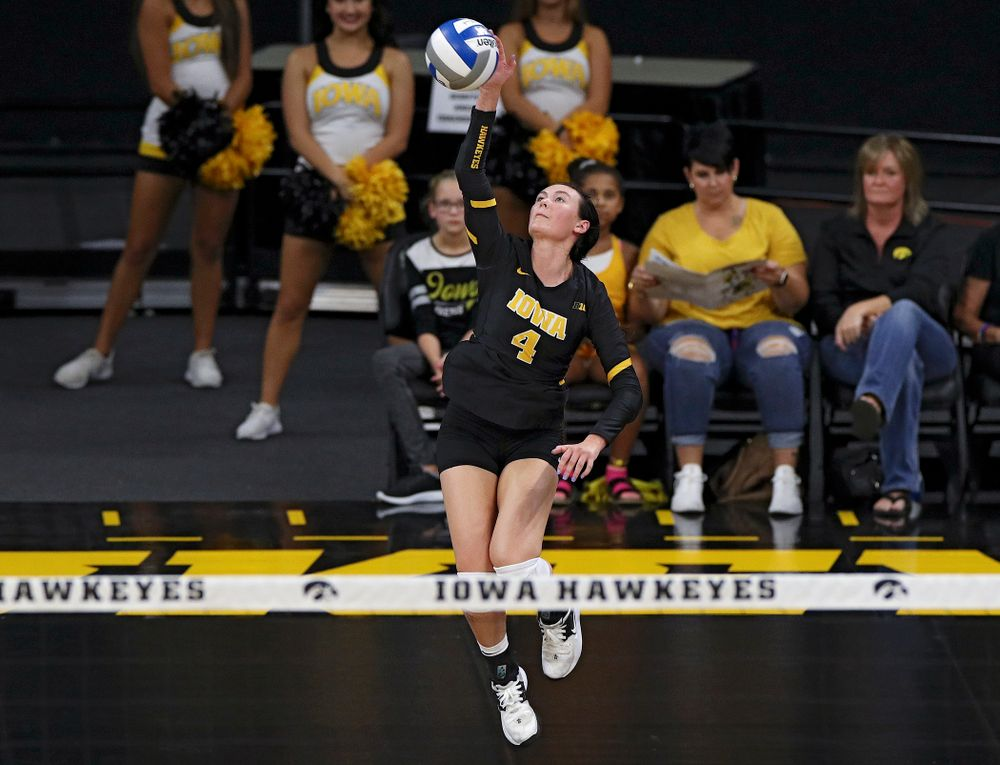 Iowa's Halle Johnston (4) serves during the first set of their Big Ten/Pac-12 Challenge match against Colorado at Carver-Hawkeye Arena in Iowa City on Friday, Sep 6, 2019. (Stephen Mally/hawkeyesports.com)
